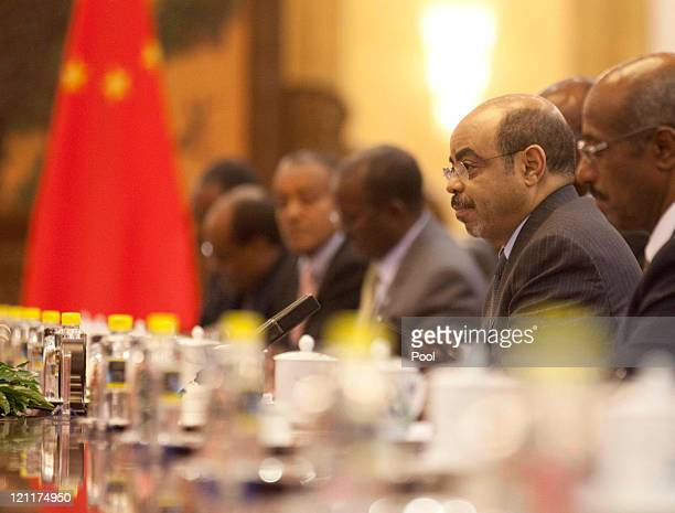 Ethiopian Prime Minister Meles Zenawi looks on during a meeting with Chinese Premier Wen Jiabao at the Great Hall of the People meet on August 15...