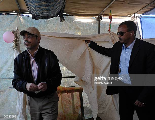 Ethiopian Prime Minister Meles Zenawi prepares to cast his vote at a polling station in Adwa 900km north 23 May 2010 of the capital Addis Ababa...