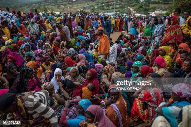TOPSHOT Ethiopian refugee women wait to receive nonfood items distributed by the Kenyan Red Cross at the newly built Somare refugee camp in Moyale...