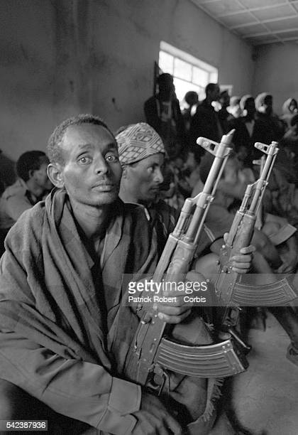 Ethiopian refugees from the border war between Eritrea and Ethiopia gather together brandishing assault rifles