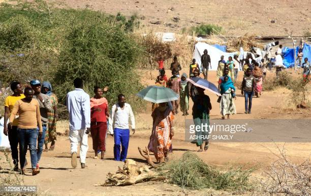 Ethiopian refugees who fled the fighting in Tigray Region are pictured at Umm Rakuba camp in eastern Sudan's Gedaref State, on November 30, 2020.