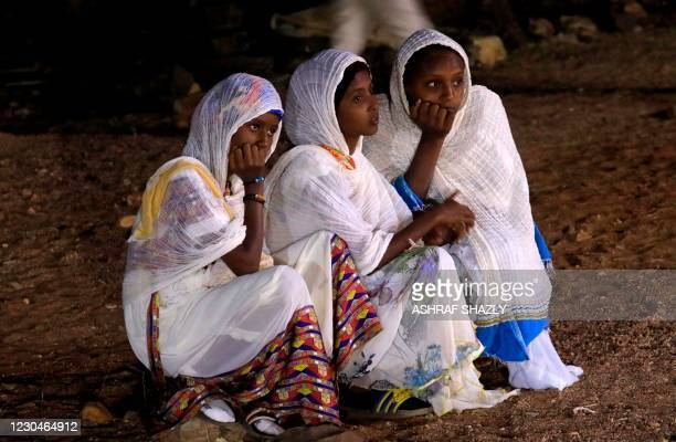 Ethiopian refugees who fled the Tigray conflict attend the Coptic Christmas midnight mass, in front of an Ethiopian Orthodox church built by former...