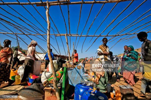 Ethiopian refugees who fled the Tigray conflict, start building temporary huts at Um Raquba camp in Sudan's eastern Gedaref province on November 28,...