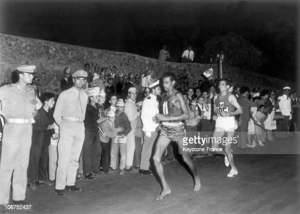 Ethiopian Runner Abebe Bikila Ahead Of Morocan Rhadi Ben Abdesselem Pictured September 11 1960 At Night During The Rome Olympic Games Marathon