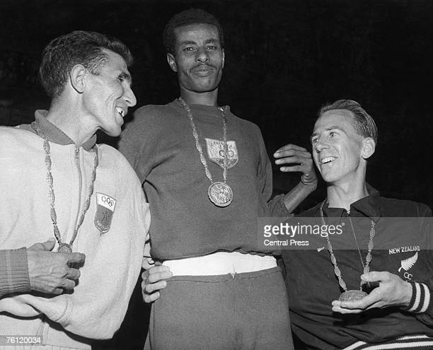 Ethiopian runner Bikila Abebe with his gold medal after winning the marathon at the 1960 Olympics in Rome 12th September 1960 Abdeslon Rhadi of...