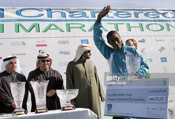 Ethiopian runner Birhane holds her trophy and a 250000 dollars cheque after winning the Dubai Marathon 2008 the world's richest marathon in Dubai 18...