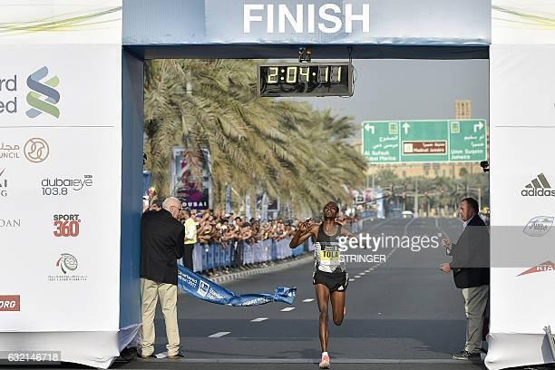 Ethiopian runner Tamirat Tola crosses the finish line to win the men's marathon in Dubai on January 20 2017 Middle distance legend Kenenisa Bekele...