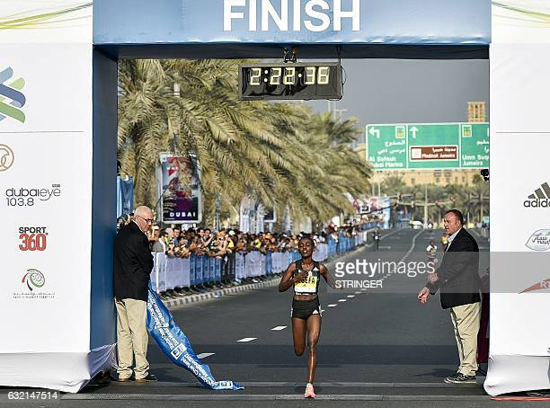 Ethiopian runner Worknesh Degefa crosses the finish line to win the women's marathon in Dubai on January 20 2017 2236 in her very first marathon /...