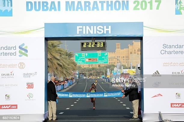 Ethiopian runner Worknesh Degefa crosses the finish line to win the women's marathon in the Standard Chartered Dubai Marathon 2017 in Dubai United...