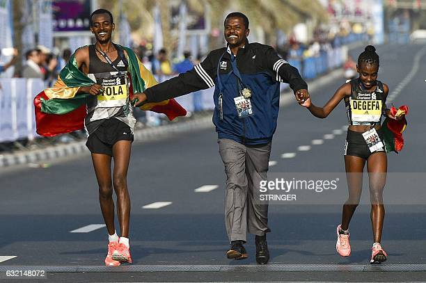 TOPSHOT Ethiopian runners Worknesh Degefa and Tamirat Tola celebrate after winning the Dubai marathon on January 20 2017 Middle distance legend...