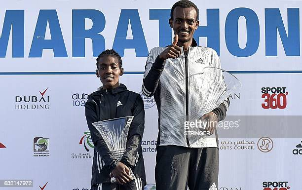 Ethiopian runners Worknesh Degefa and Tamirat Tola celebrate on the podium after winning the Dubai marathon on January 20 2017 Middle distance legend...