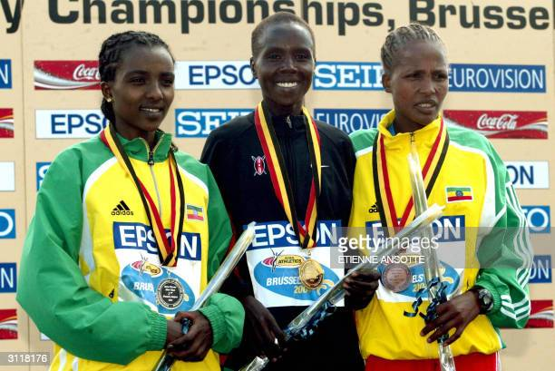 Ethiopian secondplaced Tirunesh Dibaba winner Edith Masai of Kenya and Ethiopian third placed Teyba Erkesso celebrate on the podium of the women...