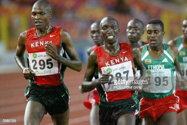 Ethiopian Sileshe Sihen gold medalist at the men''s 10000 meter race tries to run past Kenyans Gilbert Okari and Sammy Kipketer 12 October 2003 at...