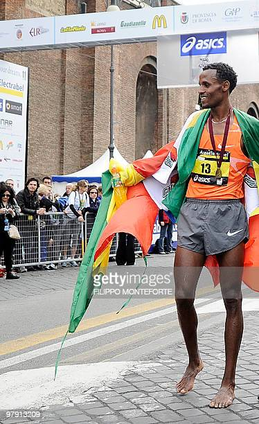 Ethiopian Siraj Gena's stands barefoot after winning the 16th Rome Marathon 'Maratona di Roma' on March 21 2010Gena arrived barefoot in memory of...