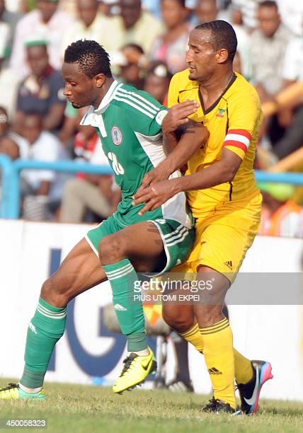 Ethiopian skipper Girma Adane holds Nigerian midfielder Mikel Obi during the FIFA World Cup qualifier in Calabar in November 16 2013 Nigeria defeated...