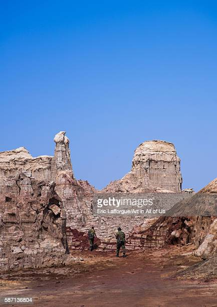 Ethiopian soldiers in the salt canyons made of layers of halite and gypsum in the danakil depression afar region dallol Ethiopia on February 26 2016...