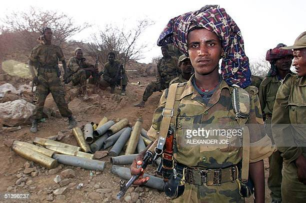 Ethiopian soldiers pose 19 May 2000 on the road 14km outside Barentu, an Eritrean town that they took 18 May. After taking control of the key town of...