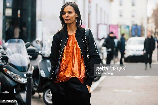 Ethiopian supermodel Liya Kebede attends the Paco Rabanne show in a black bomber jacket and orange sequin top at Mus��e d'Art Moderne Day 3 of PFW...