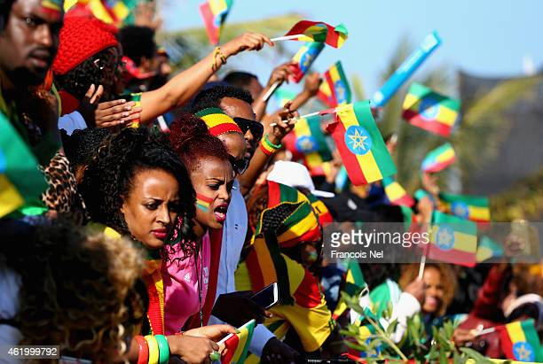Ethiopian supporters wave their country's flag during the Standard Chartered Dubai Marathon on January 23 2015 in Dubai United Arab Emirates