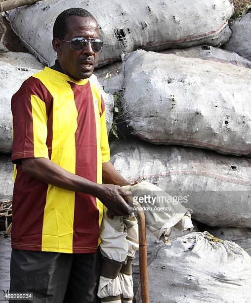 Ethiopian Tekle Aberra who lost his eyesight 8 years ago works as a charcoal seller in a corner of Merkato Africa's largest openair market on April...