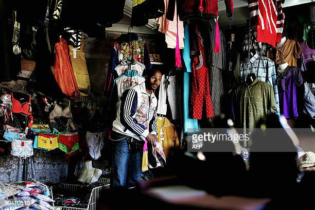 Ethiopian trader Eddie Mageyea arranges goods at his shop at the China Town market in Johannesburg on August 24 2009 South African officials say...