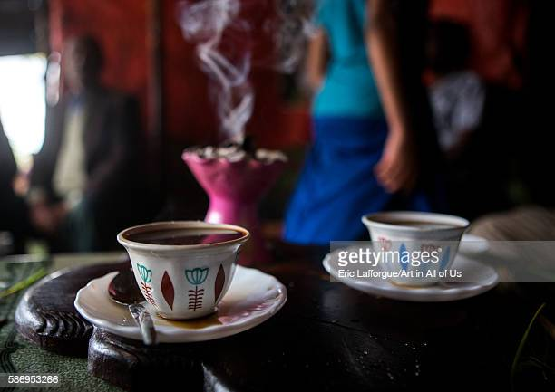 Ethiopian traditional coffee ceremony with incense burning on charcoal semien wollo zone woldia Ethiopia on February 24 2016 in Woldia Ethiopia