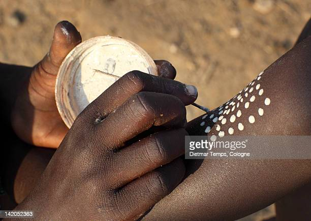 ethiopian tribes: close-up of hand painting dots - dietmar temps stock photos and pictures