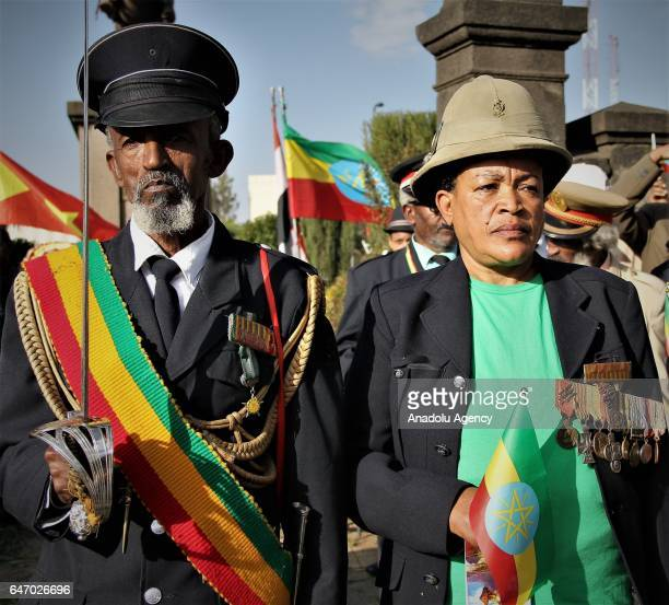 Ethiopian veteran man and woman wearing military uniform and medals stand next to each other during the celebration of the 121st Anniversary of...