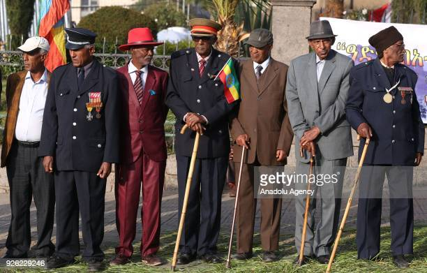 Ethiopian veterans, wearing military uniform and medals, stand next to each other during the celebration of the 122nd Anniversary of Ethiopia's...