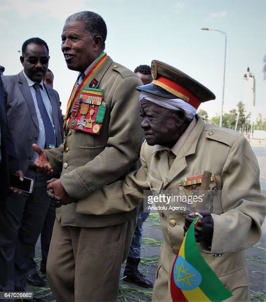 Ethiopian veterans wearing military uniform and medals walk by holding their hands during the celebration of the 121st Anniversary of Ethiopia's...