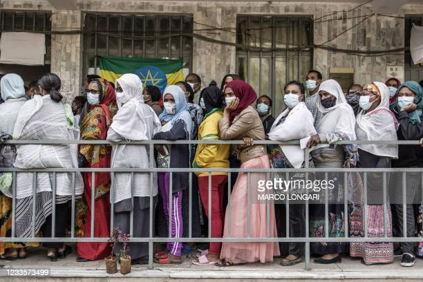 Ethiopian voters queue outside a polling station in Addis Ababa, on June 21, 2021. - Voters in Ethiopia cast ballots on June 21, 2021 in a delayed...