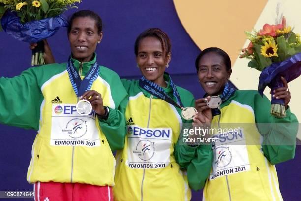 Ethiopian winners of the women's 10000m silver medal winner Berhane Adere gold medal winner Derartu Tulu and bronze medal winner Gete Wami stand on...