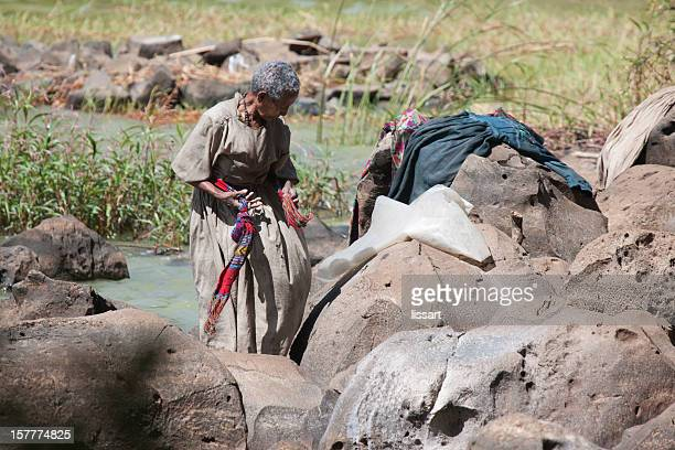 Ethiopian Woman Does Laundry at Lake
