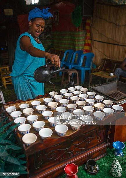 Ethiopian woman filled coffe cups in a bar semien wollo zone woldia Ethiopia on February 24 2016 in Woldia Ethiopia