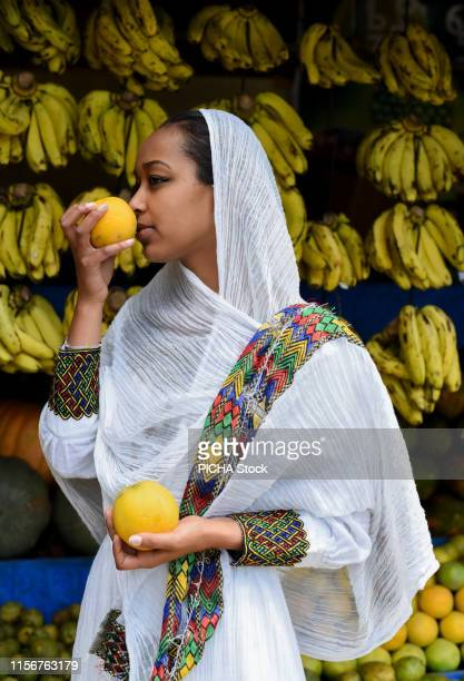 Ethiopian woman getting fruits from the market