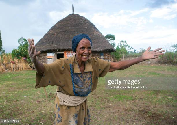 Ethiopian woman in front of her traditional painted house, Kembata, Alaba Kuito, Ethiopia on March 8, 2016 in Alaba Kuito, Ethiopia.