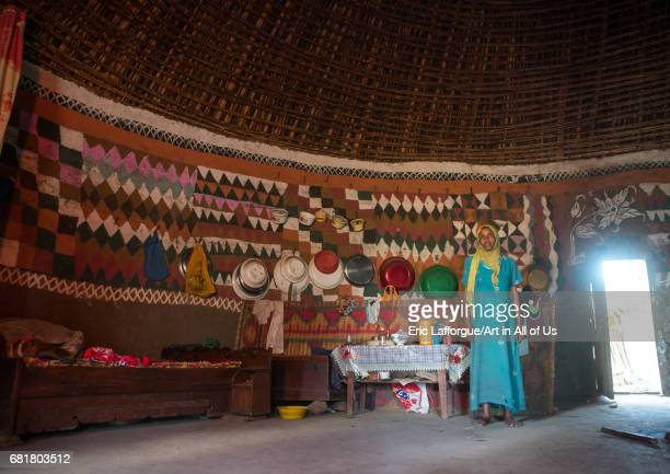 Ethiopian woman inside her traditional painted and decorated house Kembata Alaba Kuito Ethiopia on March 8 2016 in Alaba Kuito Ethiopia