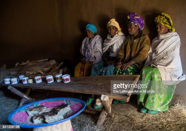 Ethiopian women from the highlands in a house to share a drink and eat bread on January 23 2017 in Debre Birhan Ethiopia
