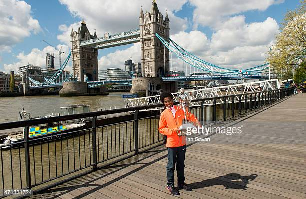 Ethiopian women's winner Tigist Tufa poses during a photocall after winning the London Marathon at the Tower Hotel on April 27, 2015 in London,...