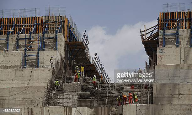 Ethiopian workers construct on March 31, 2015 the Grand Renaissance Dam near the Sudanese-Ethiopian border. Ethiopia began diverting the Blue Nile in...