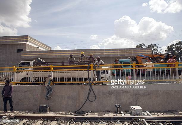 Ethiopian workers that are contracted to work on the lightrail project are pictured near the Kality Depot in Addis Ababa on April 3 2015 The train...