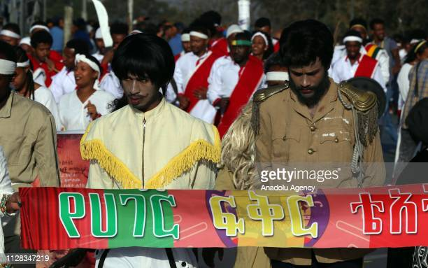 Ethiopians attend a parade to mark the 123rd anniversary of the battle of Adwa in which Ethiopia inflicted a crushing defeat on Italy's colonial army...