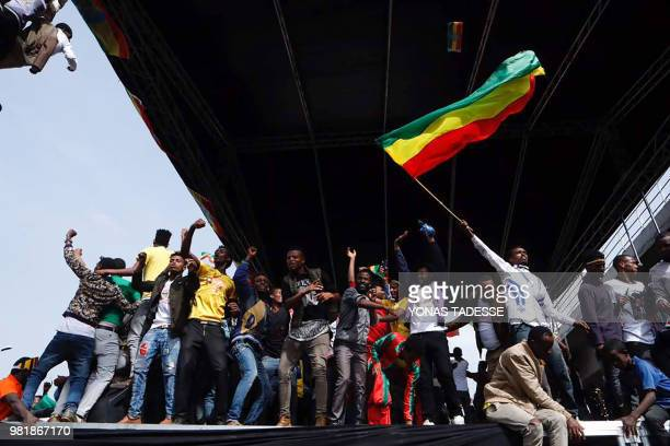 Ethiopians cheer on stage during a rally called by Prime Minister Abiy Ahmed on Meskel Square in Addis Ababa on June 23 2018 A small blast sparked...