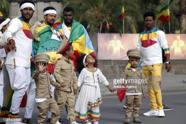 Ethiopians children wearing traditional clothes take part in a celebration marking the 125th anniversary of Ethiopia's victory over Italy at the...