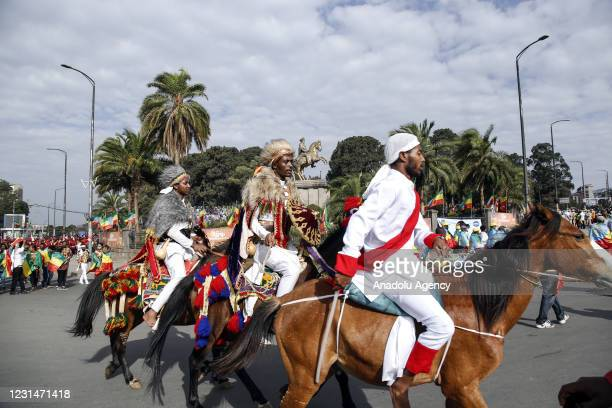 Ethiopians, dressed in traditional clothes, ride horses at Menelik II Square in the capital Addis Ababa on March 02, 2021 during an event to...