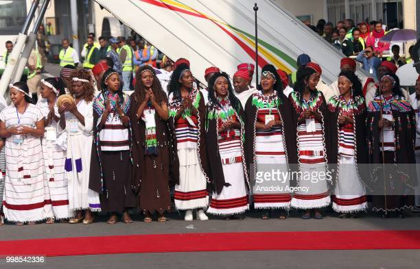 Ethiopians in national clothes gather at the Addis Ababa Bole International Airport for the arrival of the Eritrean President Isaias Afewerki after...