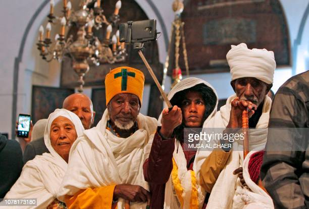 Ethiopians pray inside the Church of the Nativity traditionally regognised by Christians to be the birthplace of Jesus Christ in the occupied West...