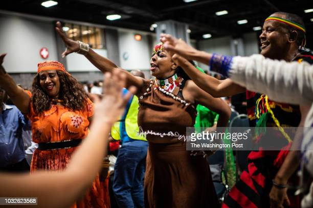 Ethiopians sing and dance ahead of the newlyelected Ethiopian Prime Minister Dr Abiy Ahmed speech at Walter E Washington Convention Center on...