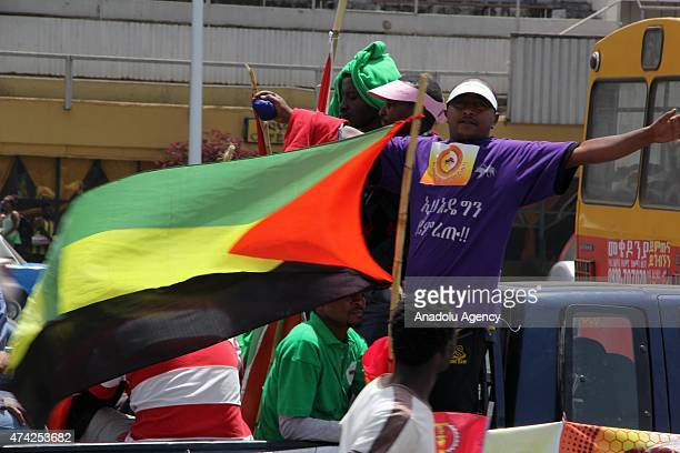 Ethiopians support the Ethiopian Peoples Revolutionary Democratic Front party attend an election rally by the EPRDF on May 21 2015 in Addis Ababa...