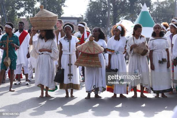Ethiopians wearing tradition clothes attend an event to mark the 122nd Anniversary of Ethiopia's Battle of Adwa at King II Menelik Square in Addis...